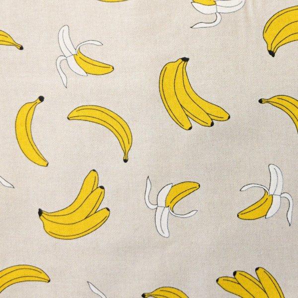 Režná dekorační látka textil s žlutými loupanými banány