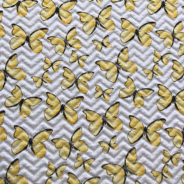 látka úplet viskózový s elastanem metráž na jarní letní šaty sukně motýli žlutí bílá