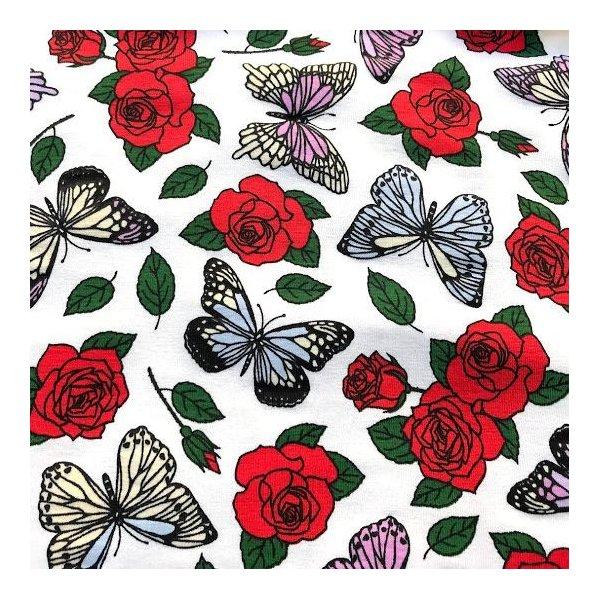 Látka úplet měnící barvu s růžemi a motýli barevná červená bílá magická kouzelná