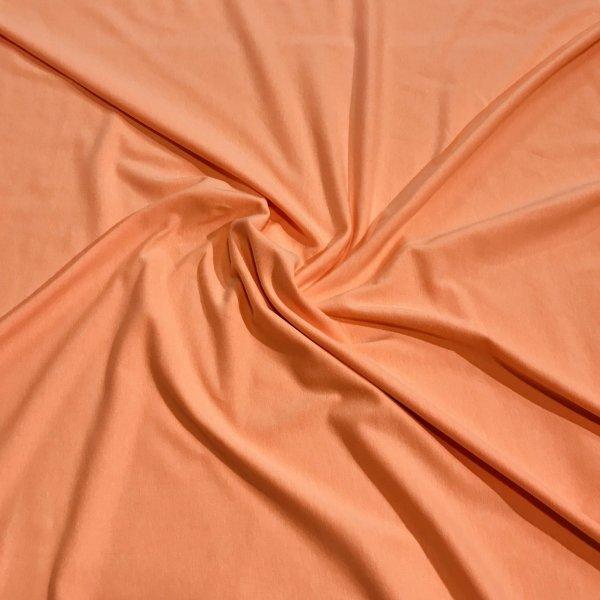 Úplet žerzej metráž polyester elastan neonově oranžová reflexní na trika sukně