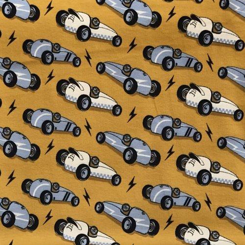 Látka metráž žerzej kreslená stará závodní auta formule hořčicově žlutá okrová