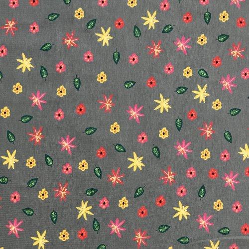Elastická látka úplet barevné žluté červené květinky lístky na šedé